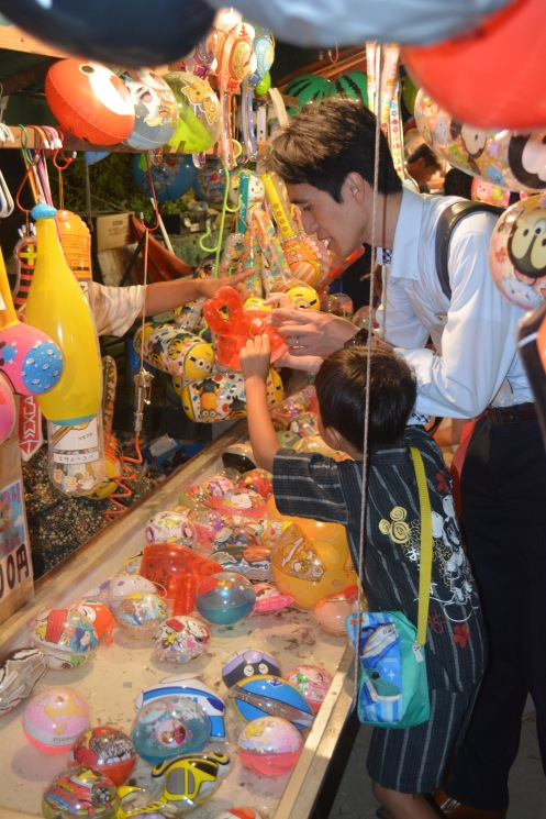 Family fun at the Tenjin Matsuri street festival, Osaka, Japan. Photo by Sydney Solis.