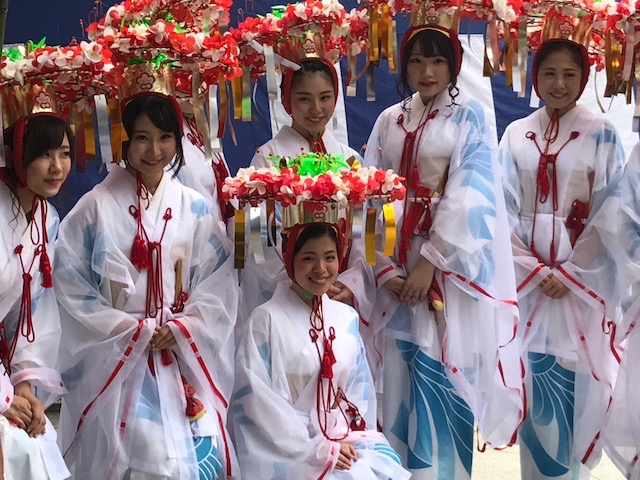 Miko, or shrine maidens, are like priestesses at the Temmangu Shinto Shrine Tenji Matsuri Festival, Osaka, Japan. Photo by Sydney Solis