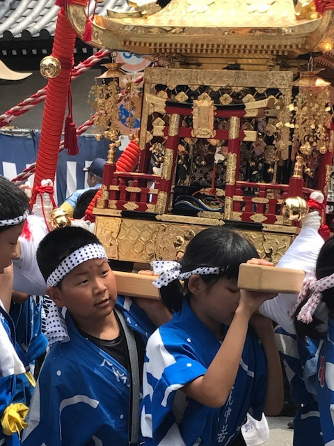 Children carrying portable shrine at the Tenjin Matsuri Festival, Osaka, Japan. Photo by Sydney Solis