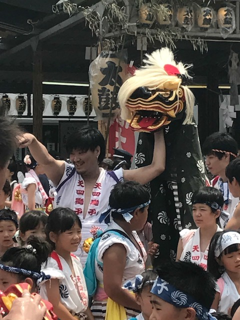 Shinshi, lion, mask at Temmangu Shinto Shrine during Tenjin Matsuri Festival, Osaka, Japan. Photo by Sydney Solis
