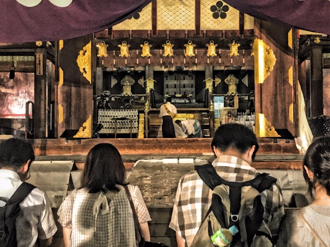 Worshipers pray at the main shrine of Temmangu Shinto Shrine during Tenjin Matsuri Festival, Osaka, Japan. Photo by Sydney Solis