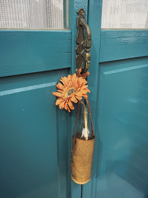 Flower in vase hanging from door, Kyoto, Japan