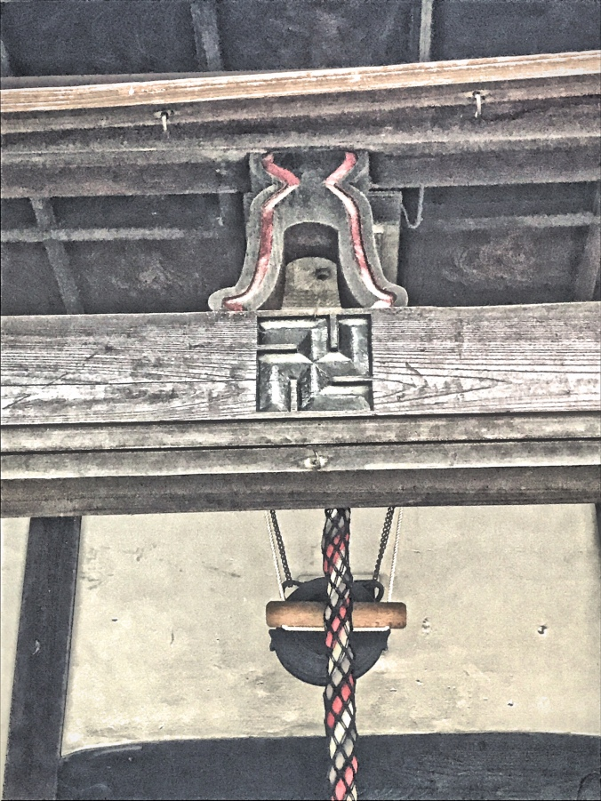 Shinto Shrine with swastika near Nishikujo Station in Osaka, Japan. Photo by Sydney Solis