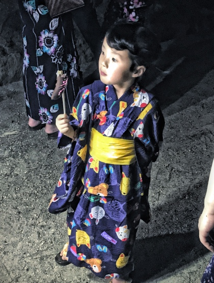 Japanese child with a choco-banana.