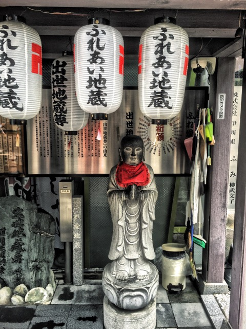 Buddhist Shrine with swastika lanterns in Osaka, Japan. Photo by Sydney Solis