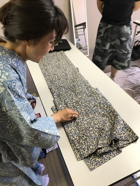 Yumi Ayama teaching about kimono patterns in her kimono dressing classes at Community House Information Center in Kobe, Japan.