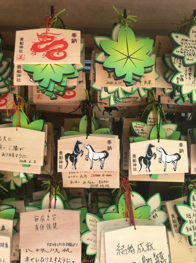 Black and white horse emas at Kifune Shinto Shrine, Kibune, Japan.
