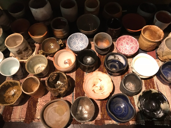 A plethora of sake cups, all one-of-a-kind and hand-made by Japanese artisans.