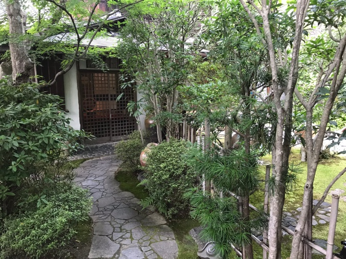 Beautiful garden and entry of the Sukiya Japanese traditional style house.