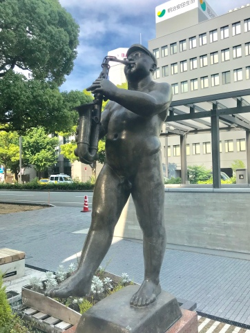 Sculpture of man with saxophone, HImeji, Japan. Photo by Sydney Solis