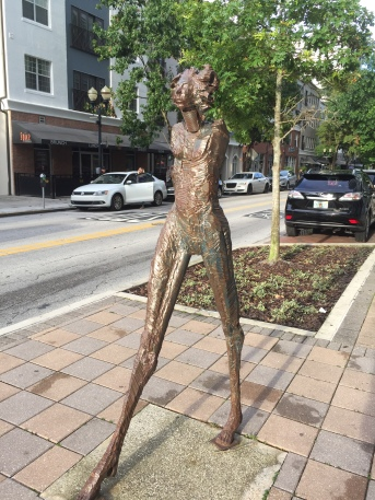 Sculpture of a woman outside the Publix Grocery Store in downtown Orlando, Florida Photo by Sydney Solis
