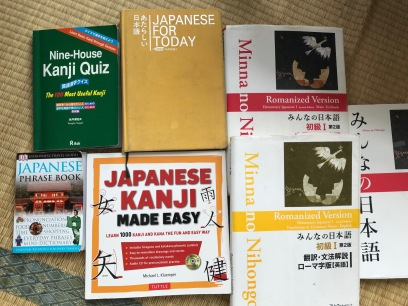 Japanese language book collection Ive acquired! Many given to me or found, or the Berlitz textbooks. We started out in Romaji, even though they said it would be easier to dive into the Hiragana, Katakana first. After a while I asked for that. FUN!