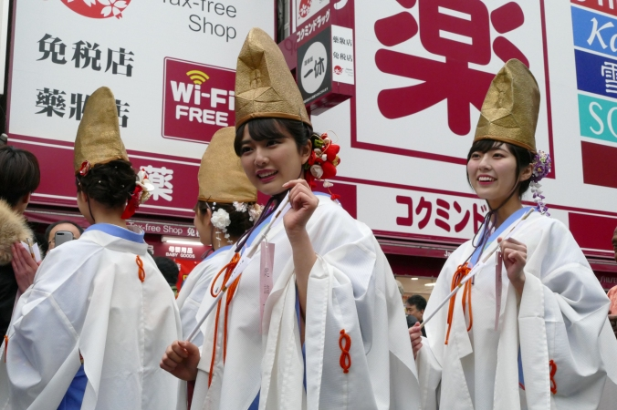 Miko, shrine maidens, are part of the parade.