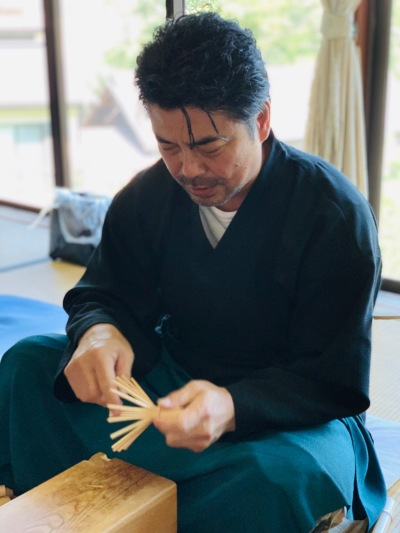 Tango Tanimura demonstrates making a chasen, tea whisk, from bamboo at his workshop in Ikoma City, Nara Prefecture, japan.