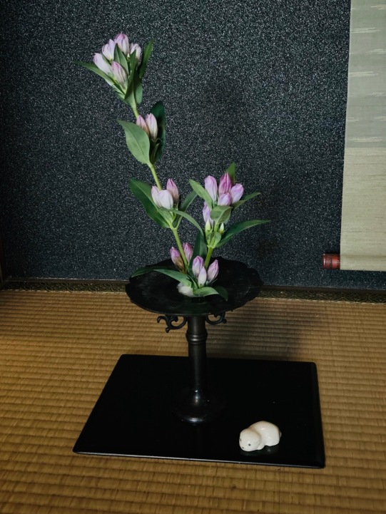 Flowers are a part of the tea house culture. These are free form arranged. It's thrown in and not styled as ikebana is.