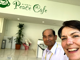 Atomic bomb survivor Inousuke Miyazaki and Sydney Solis at the Peace Cafe in Nagasaki, Japan. Love thy enemy as thy self!
