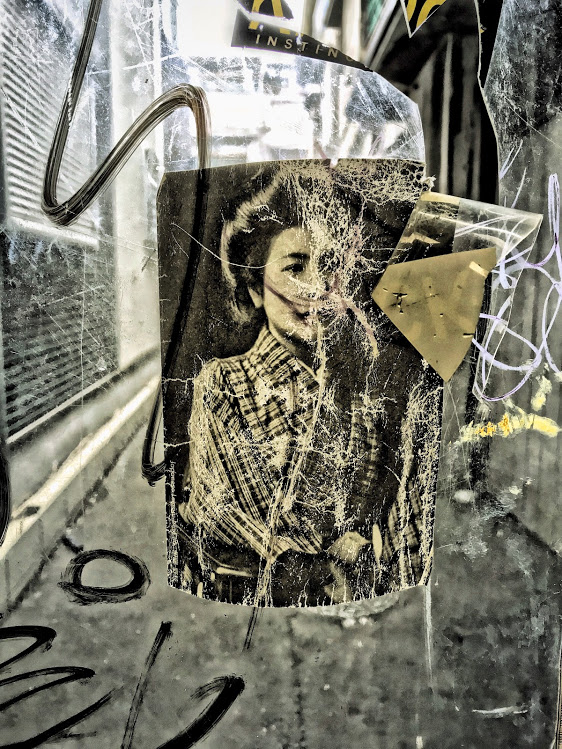 Photo of woman on plastic curtain in the Shinsekei shopping street. Photo by Sydney Solis. Metal print available at Society6.