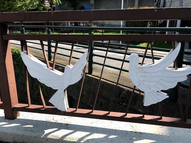 Peace doves on bridge, Nagasaki, Japan. Photo by Sydney Solis.