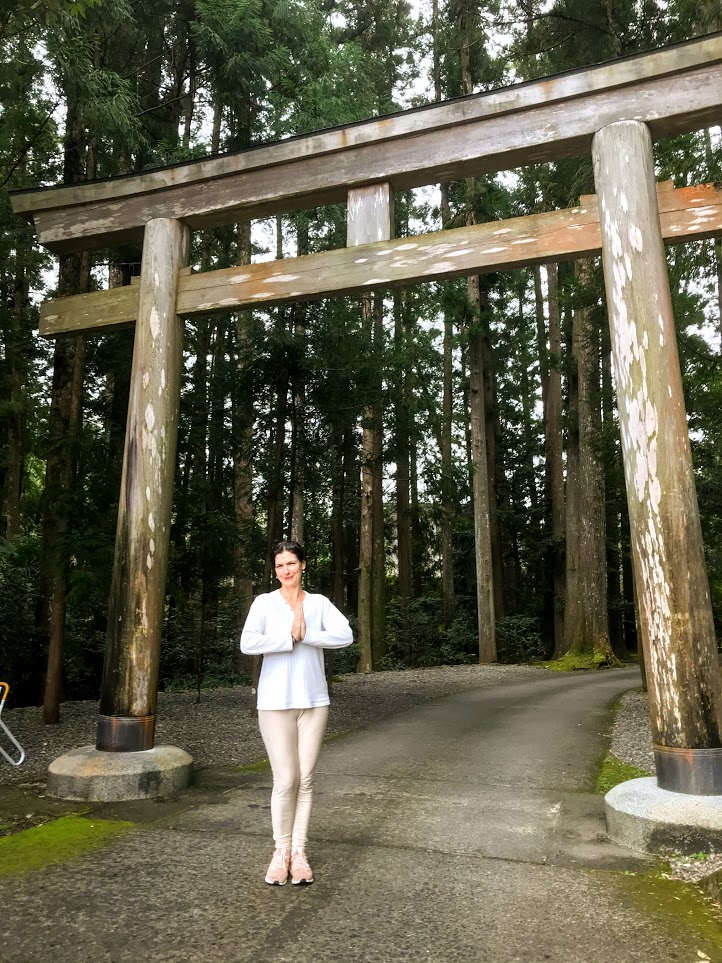 Sydney Solis at the Back end of Hongu Taisha Shinto Shrine and entering the forest to begin the walk on the dark path, the Kumano Kodo.