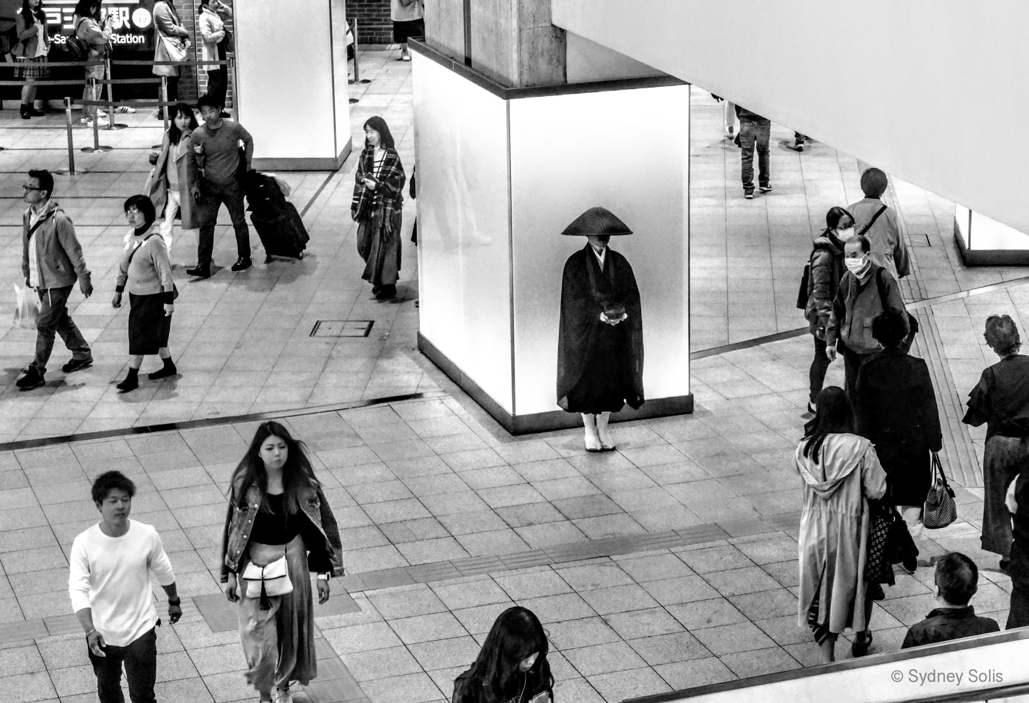Zen monk in Umeda Station, Osaka, Japan photo by Sydney Solis.