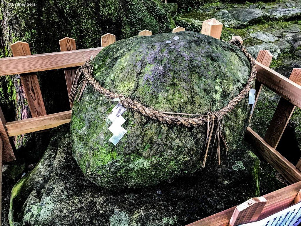 Sacred rock at Nachi Waterfall in Japan at the Hiro Jinja Shinto Shrine. Photo by Sydney Solis.