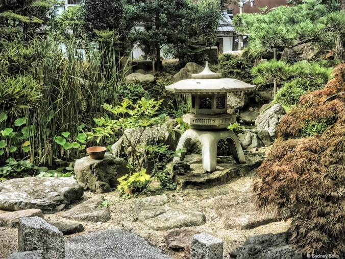 Japanese lantern in garden at Buddhist Temple, Osaka, Japan